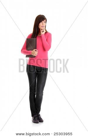 Happy student girl looking upper left corner, isolated on white