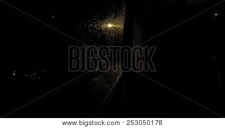 Car window in rainy night for background