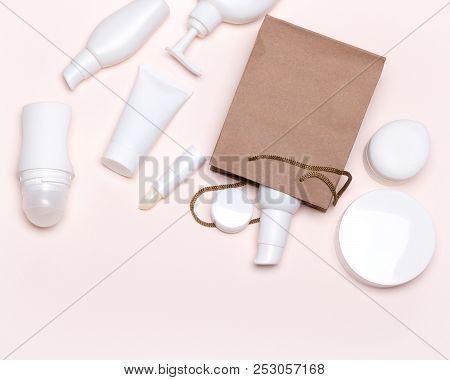 Cosmetic Products With Paper Packaging Bag. Beauty Shopping Concept With Copy Space, Flat Lay