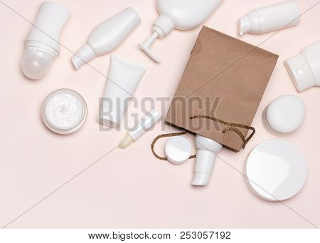 Cosmetic Products With Paper Merchandise Bag. Beauty Shopping Concept. Flatlay, Copy Space