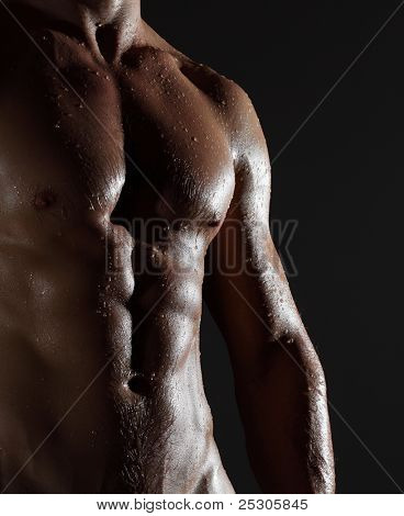 Part of a wet man's body on a gray background poster