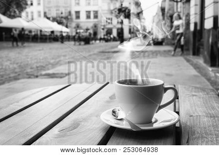 Cup Of Coffe On The Table Of The Outdoor Cafe On The Italian Sidewalk.