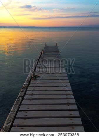 A Beautiful Sunset In The Golden Hour And Background Of A Beautiful Sky And Calm Water Shot With A P