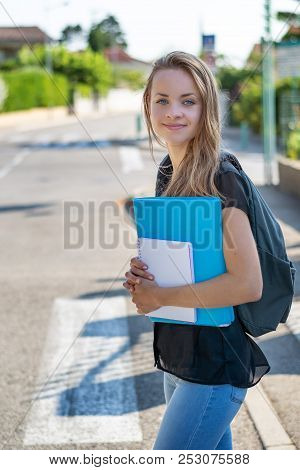 Back To School. Student Girl Holding Books And Carry School Bag While Walking To School. Urban Backg