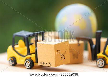Mini Forklift Trucks Load Cardboard Box With Online Shopping Symbol With Nature Background And Globe