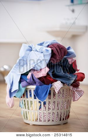basket of dirty washing in bathroom poster