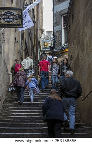 Edinburgh, Scotland  - August 7: Festival Attendees Walking In A Close Alley At The Edinburgh Fringe