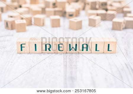 The Word Firewall Formed By Wooden Blocks On A White Table