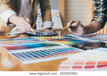 Young Creative Team Having A Meeting In Creative Office, Architectural Drawing With Work Tools And A