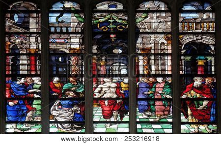 PARIS, FRANCE - JANUARY 09: The Incredulity of Saint Thomas, stained glass window from Saint Germain-l'Auxerrois church in Paris, France on January 09, 2018.