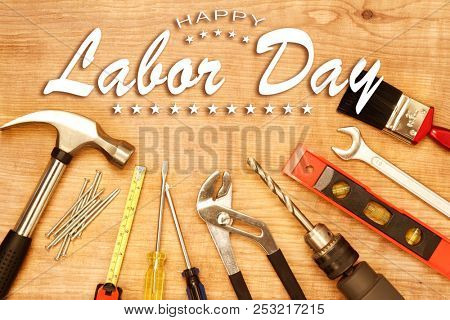Happy Labor Day. Tools on wood