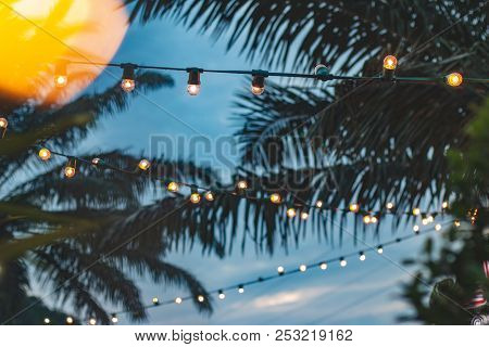 Blurred Light Bokeh With Coconut Palm Tree Background On Sunset, Yellow String Lights With Bokeh Dec