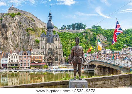Dinant,belgium - May 22,2018 - View At The Enbankment Of Meuse River With Mwmorial And Bridge Of Cha