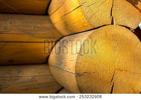 Wooden Logs Blockhouse With Sunbeam Closeup Background