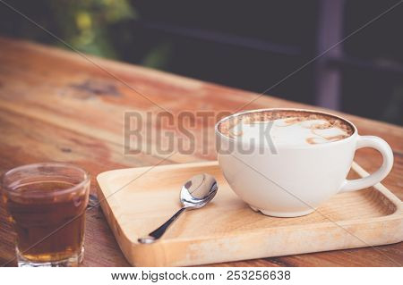 Cup Of Coffee On Wooden Table Vintage Tone.