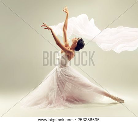 Ballerina. Young Graceful Woman Ballet Dancer, Dressed In Professional Outfit, Shoes And White  Weig