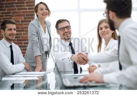 handshake financial partners at the Desk