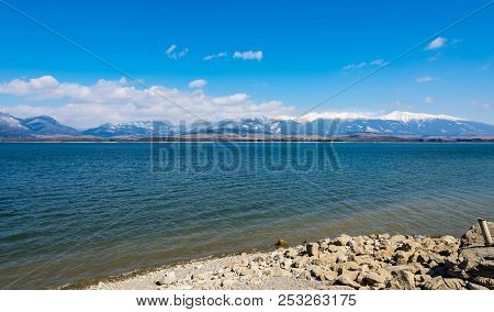Slovakia: Liptovska Mara Lake With The Tatra Mountains In The Background. Winter Mountains, Clouds