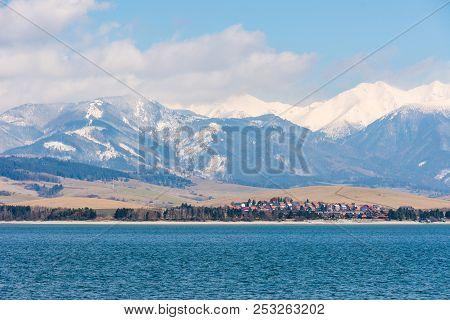 Slovakia: Small Village Near The Tatra Mountain. Liptovska Mara Lake In Foreground. Winter And Snow