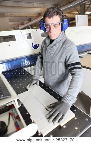 Man wearing ear defenders in a factory