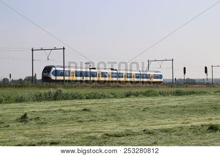 Local Commuter Train On The Track At Moordrecht Heading To Rotterdam In The Netherlands