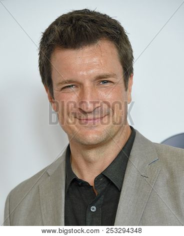 LOS ANGELES - AUG 07:  Nathan Fillion arrives to the ABC TCA Summer Press Tour White Carpet Event  on August 7, 2018 in Hollywood, CA