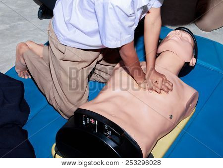 Hand Student Heart Pump With Medical Dummy On Cpr, In Emergency Refresher Training To Assist Of Phys