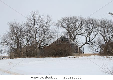 An Abandoned Farm House On A Abandoned Farm Site During The  Winter In North Eastern North Dakota.