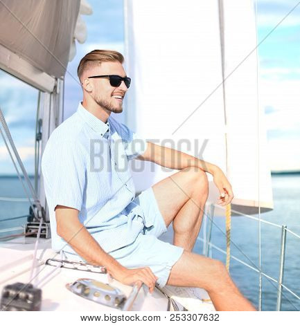 Relaxing Man Sitting On Boat Sailing On Sea Happy And Carefree.