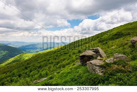 Beautiful Summer Landscape In Mountains. Grassy Hill Under The Cloudy Sky. Wonderful Nature Backgrou