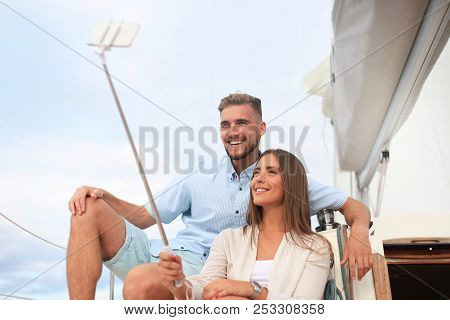 Happy Couple In Love Taking Selfie On Sailing Boat, Relaxing On A Yacht At The Sea.
