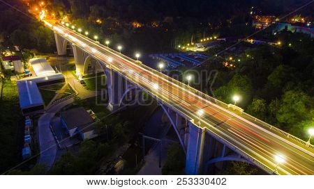 Drone View Of The Illuminated Matsesta Viaduct And Mountainside With Dense Forest At Dusk, Sochi, Ru