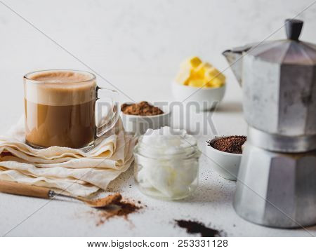 KETOGENIC KETO DIET DRINK. Coffe and cacao blended with coconut oil. Cup of bulletproof coffe with cacao and ingredients on white background poster