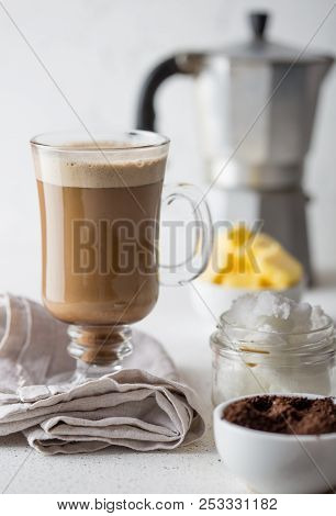 BULLETPROOF COFFEE. Ketogenic keto diet coffe blended with coconut oil and butter. Cup of bulletproof coffee and ingredients on white background poster