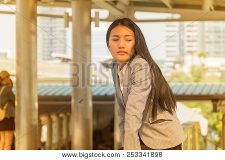 Beautiful Young Asian Woman Sitting Discouraged On The Marble Floor In Modern City.