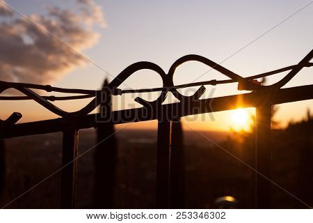 A Barbed Wire Contrasted On A Dusk Sun Light Background