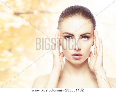 Portrait Of Young, Natural And Healthy Woman Over Yellow Autumn Background. Healthcare, Spa, Makeup