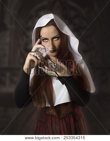 Mysterious Young Woman Or Sorceress Holding A Magic Crystal.