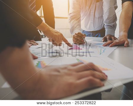 Group Of Businessman Meeting Analyze The Company Performance And Growth Corporate With Information D