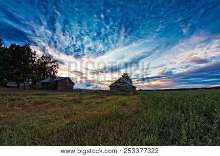 The Late Summer Sun Sets Beautifully Behind The Old Barn Houses In The Northern Finland. The Nights