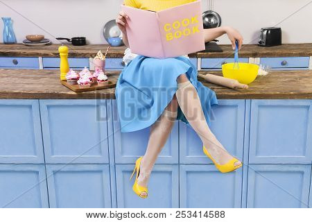 Colorful Retro / Pin Up Girl Woman Female Housewife Wearing Yellow Top, Skirt And White Apron Sittin