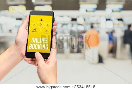 Close Up Hand Holding Mobile Phone And Touch On Screen With Online Booking Word With Feature Icon At