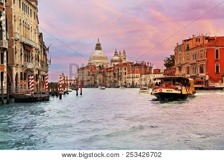 Jun 8, 2018 Venice Italy - View Of Grand Canal With Ferry In Foreground And Basilica Di Santa Maria
