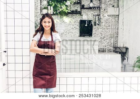 Portrait Of Woman Small Business Owner Smiling And Standing With Crossed Arms Outside The Cafe Or Co