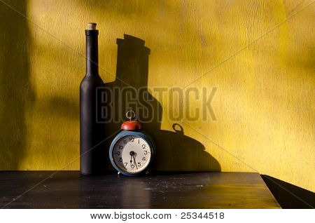 Stiil-life With Black Bottle And Old Clock