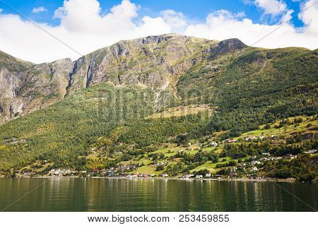 Landscape With Naeroyfjord, Mountains And Traditional Village Houses In Norway.