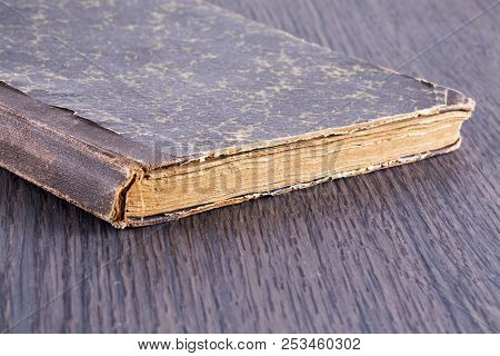 Old Book Over Wooden Table