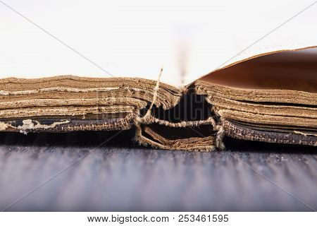 Open Old Book Over Wooden Table