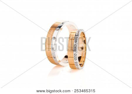 Pair Of Rose Gold And White Gold Wedding Ring With Diamonds Isolated On White Background