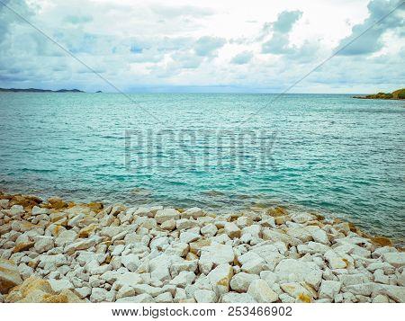 Rocky Pebble Coast Beach Seascape On Idyllic Ocean And Cloudy Sky,khao Laem Ya Nation Park Thailand,